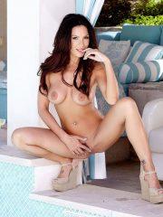 Kirsten Price poses naked outdoors