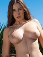Big breasted babe Connie Carter strips down naked