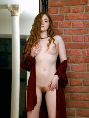 Young redhead Anicka slips off
