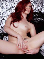Pale redhead su[erb model Elle Alexandra satisfies her horny cunt
